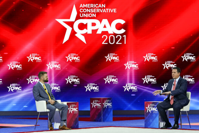 Trent England, left, of Save Our States interviews Rep. Devin Nunes, R-Calif., at the Conservative Political Action Conference (CPAC) Saturday, Feb. 27, 2021, in Orlando, Fla. (AP Photo/John Raoux)
