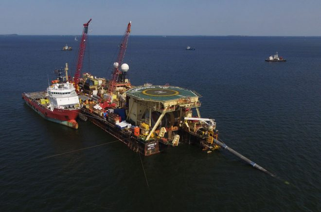 LUBMIN, GERMANY - AUGUST 16: In this aerial view the Castoro 10 pipelay vessel lays concrete-coated pipe for the Nord Stream 2 gas pipeline onto the seabed of the Baltic Sea on August 16, 2018 near Lubmin, Germany. The Nord Stream 2 pipeline will transport Russian natural gas from Narva Bay in Russia to Greifswald in Germany, creating an additional, direct natural gas route between Russia and western Europe. Both Poland and Ukraine have voiced their opposition to the Nord Stream project. (Photo by Sean Gallup/Getty Images)