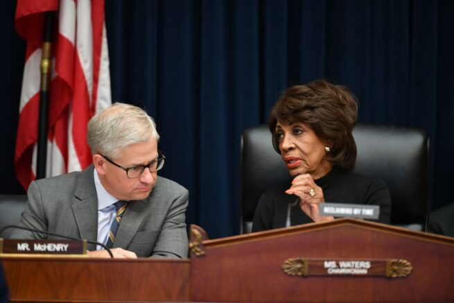 "Rep.Maxine Waters spoke with Rep. Patrick McHenry before Facebook Chairman and CEO Mark Zuckerberg testified before the House Financial Services Committee on ""An Examination of Facebook and Its Impact on the Financial Services and Housing Sectors"" in the Rayburn House Office Building in Washington, DC on October 23, 2019.  (Photo by MANDEL NGAN/AFP via Getty Images)"