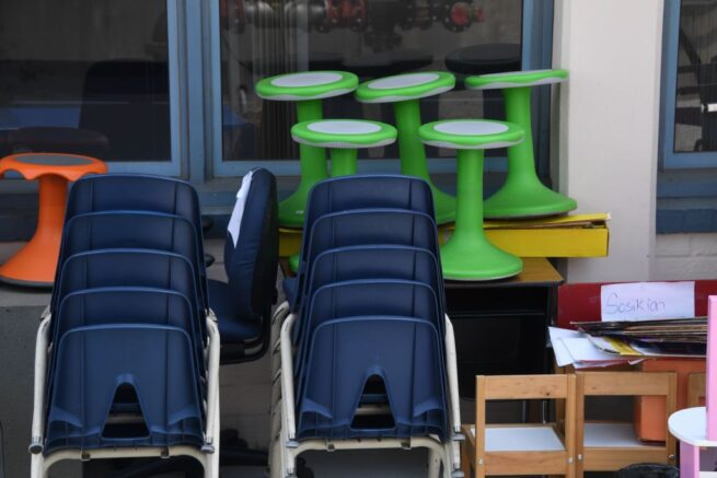Chairs, desk and other school furniture is stacked outside a classroom at a public elementary school in Glendale, California just north of Los Angeles, August 17, 2020 amid the coronavirus pandemic. - The school year starts this week with online classes only. (Photo by Robyn Beck / AFP) (Photo by ROBYN BECK/AFP via Getty Images)