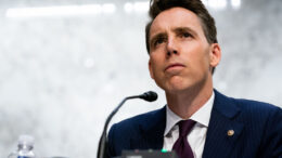 WASHINGTON, DC - OCTOBER 13: U.S. Sen. Josh Hawley (R-MO) listens while Supreme Court nominee Judge Amy Coney Barrett testifies before the Senate Judiciary Committee on the second day of her Supreme Court confirmation hearing on Capitol Hill on October 13, 2020 in Washington, DC. Barrett was nominated by President Donald Trump to fill the vacancy left by Justice Ruth Bader Ginsburg who passed away in September. (Anna Moneymaker-Pool/Getty Images)