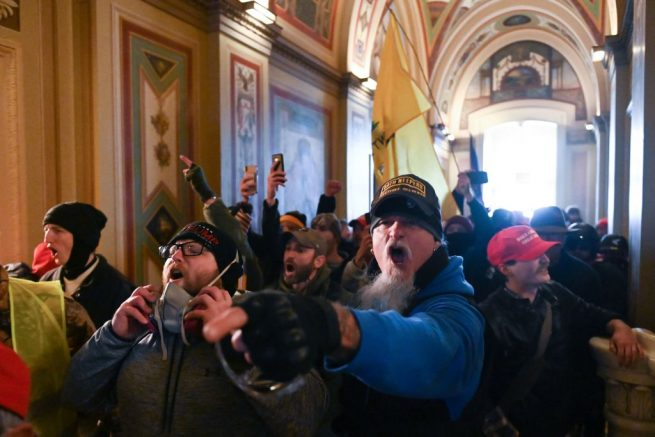 TOPSHOT - Protesters inside the US Capitol on January 6, 2021, in Washington, DC. - Demonstrators breeched security and entered the Capitol as Congress debated the a 2020 presidential election Electoral Vote Certification. (Photo by ROBERTO SCHMIDT / AFP) (Photo by ROBERTO SCHMIDT/AFP via Getty Images)