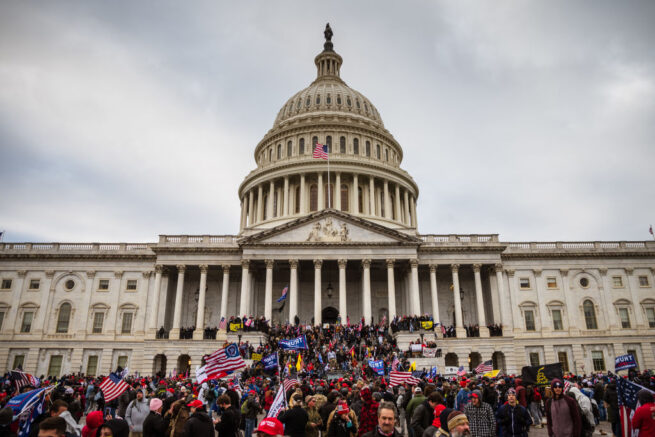 WASHINGTON, DC - JANUARY 06: A large group of protesters stood on the East steps of the Capitol Building after storming its grounds on January 6, 2021 in Washington, DC. (Photo by Jon Cherry/Getty Images)