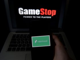This photo illustration shows the logos of video grame retail store GameStop and trading application Robinhood on a computer and on a mobile phone in Arlington, Virginia on January 28, 2021. - An epic battle is unfolding on Wall Street, with a cast of characters clashing over the fate of GameStop, a struggling chain of video game retail stores. The conflict has sent GameStop on a stomach-churning ride with amateur investors taking on the financial establishment in the mindset of the Occupy Wall Street movement launched a decade ago. (Photo by Olivier DOULIERY / AFP) (Photo by OLIVIER DOULIERY/AFP via Getty Images)