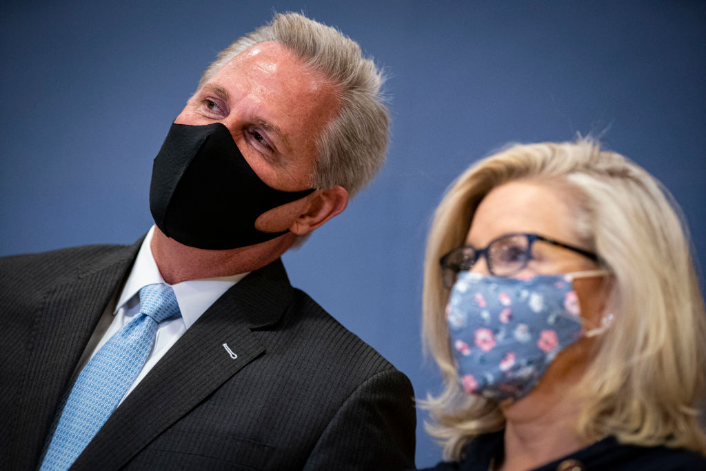 WASHINGTON, DC - FEBRUARY 24: House Minority Leader Kevin McCarthy (R-CA) whispers to Rep. Liz Cheney (R-WY) during a House Republican Leadership news conference in the U.S. Capitol on February 24, 2021 in Washington, DC. (Photo by Al Drago/Getty Images)