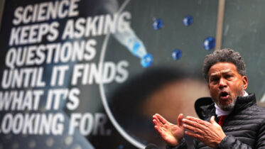 NEW YORK, NEW YORK - DECEMBER 09: Fernando Mateo speaks during a press conference in front of the Pfizer headquarters in Manhattan on December 09, 2020 in New York City. The New York State Federation of Taxi Drivers is calling on Pfizer to donate 30,000 coronavirus (COVID-19) vaccines to city drivers who have been and will continue to be on the front lines transporting patients to and from vaccine appointments. (Photo by Michael M. Santiago/Getty Images)