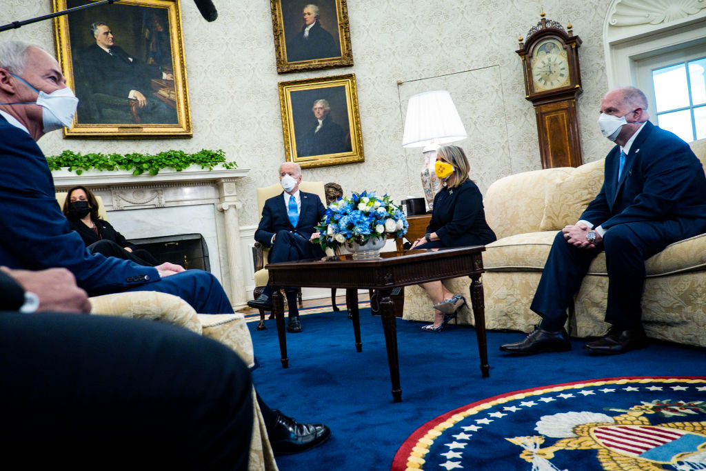WASHINGTON, DC - FEBRUARY 12: President Joe Biden and Vice President Kamala Harris meet with governors and mayors, including Governor Asa Hutchinson (R-AR), Governor Michelle Lujan Grisham (D-NM) and Governor Larry Hogan (R-MD), in the Oval Office in Washington, D.C., on Friday, Feb. 12, 2021, to discuss the vital need to pass the American Rescue Plan, which will get more support to their communities and those on the front lines of the fight against COVID-19. (Photo by Pete Marovich-Pool/Getty Images)