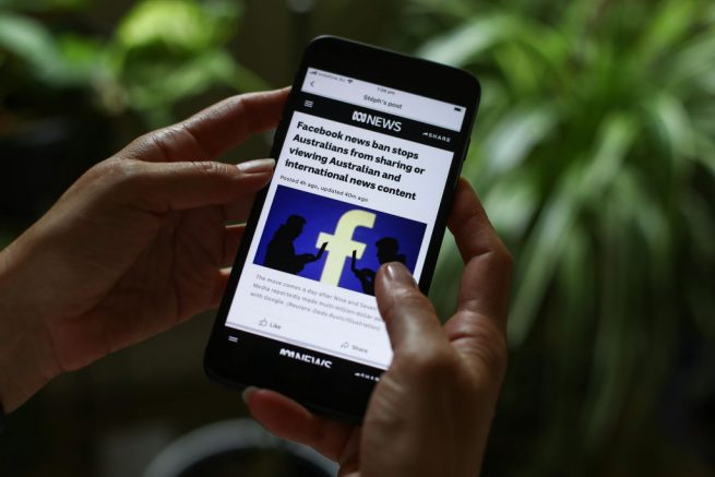 SYDNEY, AUSTRALIA - FEBRUARY 18: In this photo illustration ABC News reports on Facebook's news ban on Australian and International content on February 18, 2021 in Sydney, Australia. Facebook has banned publishers an users in Australia from posting it sharing news content as the Australian government prepares to pass laws that will require social media companies to pay news publishers for sharing using content on their platforms. (Photo by Brendon Thorne/Getty Images)