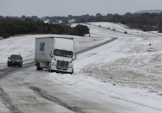 KILLEEN, TEXAS - FEBRUARY 18: A tractor trailer is stuck in the slick ice and snow on State Highway 195 on February 18, 2021 in Killeen, Texas. Winter storm Uri has brought historic cold weather and power outages to Texas as storms have swept across 26 states with a mix of freezing temperatures and precipitation. (Photo by Joe Raedle/Getty Images)