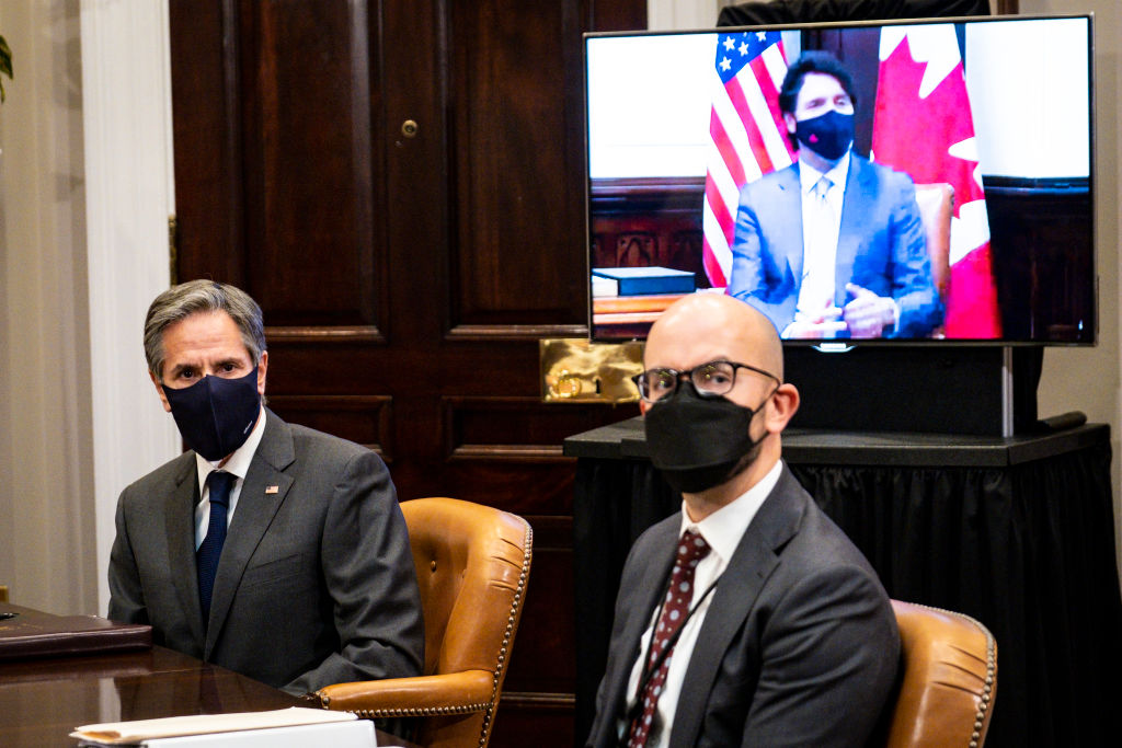 WASHINGTON, DC - FEBRUARY 23: U.S. Secretary of State Tony Blinken (L) and National Security Council Senior Director for Western Hemisphere Juan Gonzalez (R) participate in a virtual bilateral meeting with Prime Minister Justin Trudeau of Canada in the Roosevelt Room of the White House on February 23, 2021 in Washington, DC. This is Biden and Trudeau's first bilateral meeting. (Photo by Pete Marovich-Pool/Getty Images)