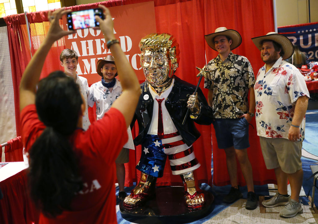 ORLANDO, FLORIDA - FEBRUARY 27: People take a picture with former President Donald Trump's statue on display at the Conservative Political Action Conference held in the Hyatt Regency on February 27, 2021 in Orlando, Florida. Begun in 1974, CPAC brings together conservative organizations, activists, and world leaders to discuss issues important to them. (Photo by Joe Raedle/Getty Images)