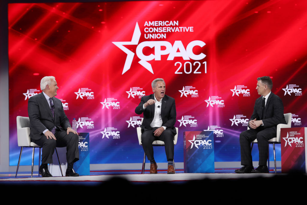 ORLANDO, FLORIDA - FEBRUARY 27: (L-R) Matt Schlapp, Moderator, American Conservative Union Chairman, Rep. Kevin McCarthy (R-CA), House Minority Leader, and Rep. Jim Banks (R-IN), participate in a discussion titled 'Winning Back America' during the Conservative Political Action Conference held in the Hyatt Regency on February 27, 2021 in Orlando, Florida. Begun in 1974, CPAC brings together conservative organizations, activists, and world leaders to discuss issues important to them. (Photo by Joe Raedle/Getty Images)