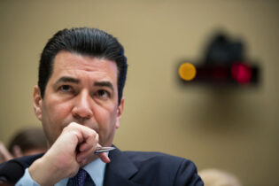 WASHINGTON, DC - OCTOBER 25: Dr. Scott Gottlieb, commissioner of the Food and Drug Administration (FDA), testifies during a House Energy and Commerce Committee hearing concerning federal efforts to combat the opioid crisis, October 25, 2017 in Washington, DC. Lawmakers on the committee threatened to subpoena information from the Drug Enforcement Agency (DEA) regarding their delayed responses about drug distributors that poured in millions of pain pills into West Virginia. (Photo by Drew Angerer/Getty Images)
