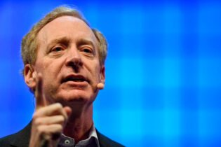 Microsoft president and chief legal officer Brad Smith delivers a speech during the 2017 Web Summit in Lisbon on November 8, 2017. - Europe's largest tech event Web Summit is being held at Parque das Nacoes in Lisbon from November 6 to November 9. (Photo by PATRICIA DE MELO MOREIRA / AFP) (Photo by PATRICIA DE MELO MOREIRA/AFP via Getty Images)