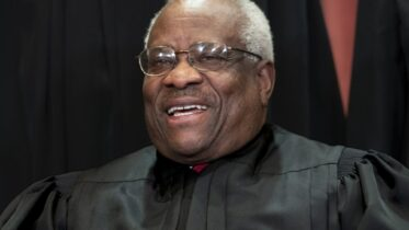 FIILE - In this Nov. 30, 2018, file photo, Supreme Court Associate Justice Clarence Thomas, appointed by President George H. W. Bush, sits with fellow Supreme Court justices for a group portrait at the Supreme Court Building in Washington. Thomas is now the longest-serving member of a court that has recently gotten more conservative, putting him in a unique and potentially powerful position, and he's said he isn't going away anytime soon. With President Donald Trump's nominees Neil Gorsuch and Brett Kavanaugh now on the court, conservatives are firmly in control as the justices take on divisive issues such as abortion, gun control and LGBT rights. (AP Photo/J. Scott Applewhite, File)
