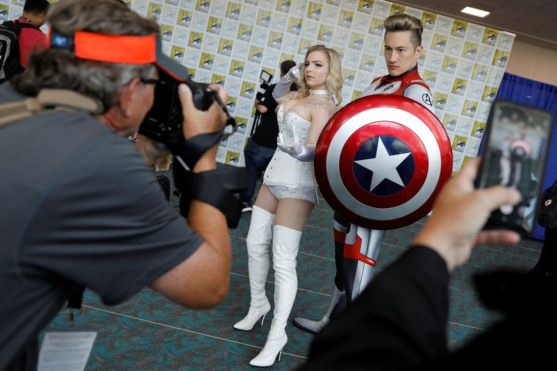 Attendees pose for a picture as they arrive in costumes to enjoy Comic Con International in San Diego