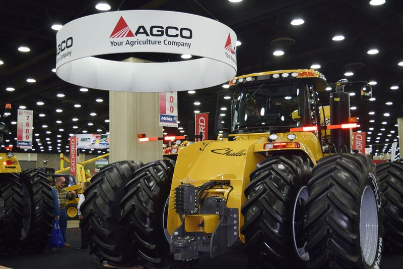FILE PHOTO: People look at AGCO equipment as they attend National Farm Machinery show in Louisville