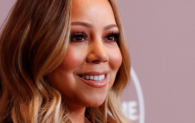 FILE PHOTO: Mariah Carey's brother files lawsuit over memoir