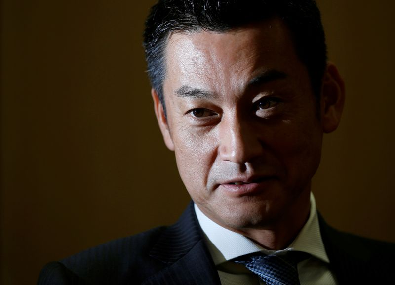 FILE PHOTO: Japan Post Bank Chief Investment Officer Katsunori Sago speaks during an interview for the Reuters Global Investment Outlook Summit in Tokyo