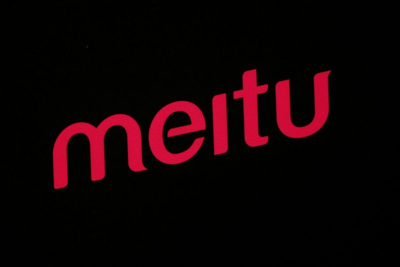 A logo of Meitu is displayed at a news conference in Hong Kong