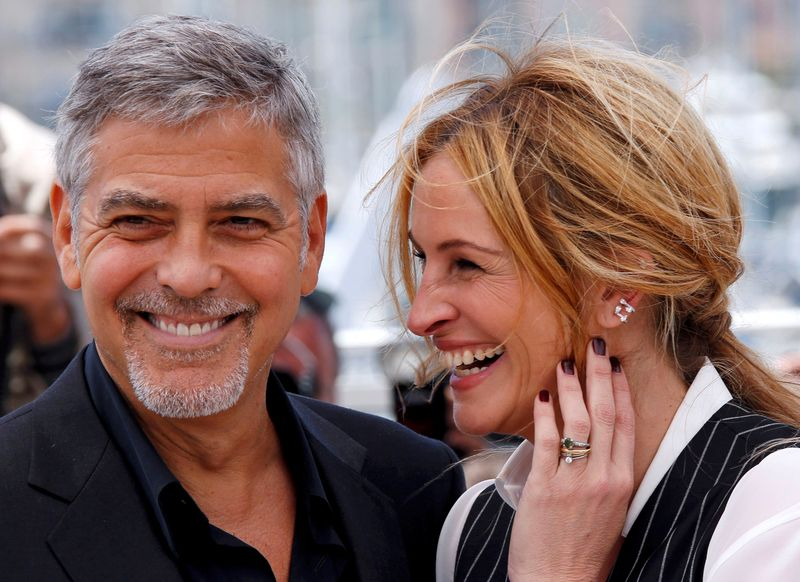 FILE PHOTO: Cast members Julia Roberts and George Clooney pose during a photocall for the film