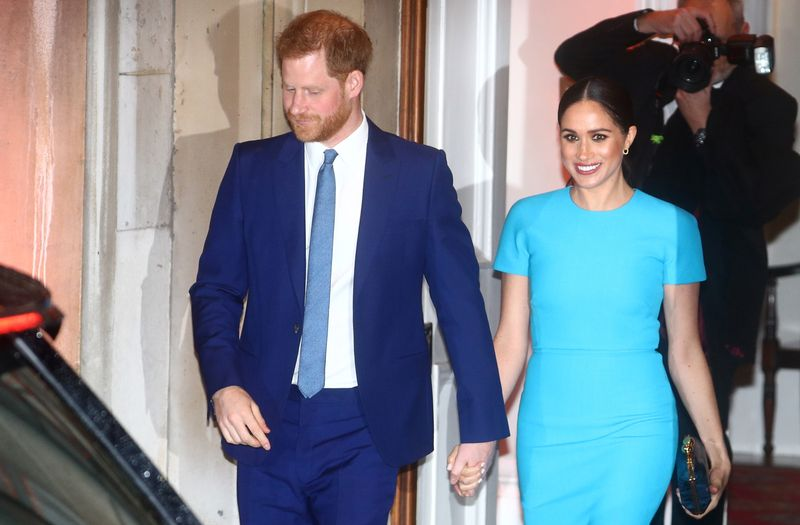 Britain's Prince Harry and his wife Meghan, Duchess of Sussex, leave after attending the Endeavour Fund Awards in London