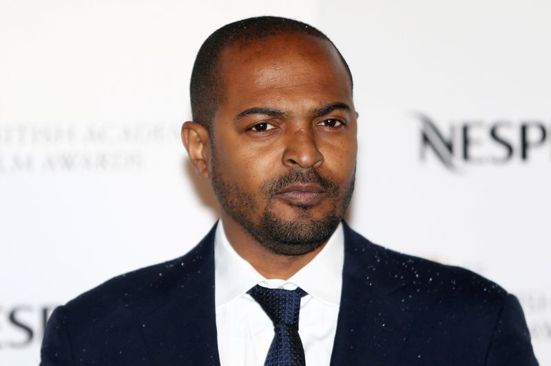 FILE PHOTO: Actor Noel Clarke poses for photographers at the British Academy Film Awards Nominees Party at Kensington Palace in London