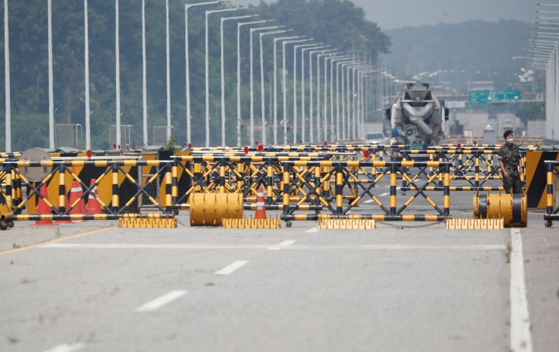 FILE PHOTO: A soldier stands guard at a checkpoint on the Grand Unification Bridge which leads to the inter-Korean Kaesong Industrial Complex in North Korea, just south of the demilitarized zone separating the two Koreas, in Paju