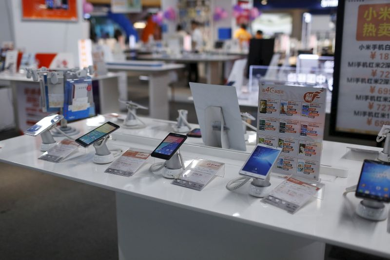 Mobile phones are seen on display at an electronics market in Shanghai