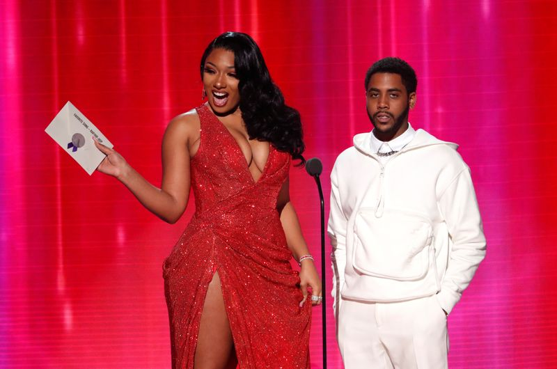 FILE PHOTO: Megan Thee Stallion and Jharrel Jerome at an award show in 2019