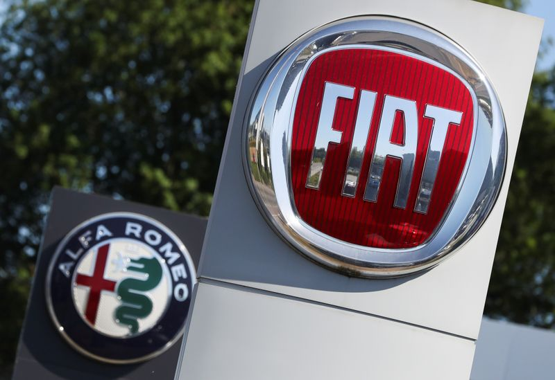 Logos of Fiat and Alfa Romeo are seen outside a car dealer, amid the coronavirus disease (COVID-19) outbreak in Brussels