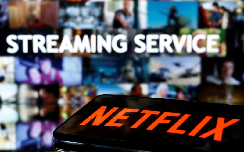 FILE PHOTO: A smartphone with the Netflix logo lies in front of displayed