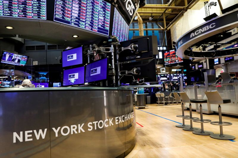 FILE PHOTO: A nearly empty trading floor is seen as preparations are made for the return to trading at the NYSE in New York