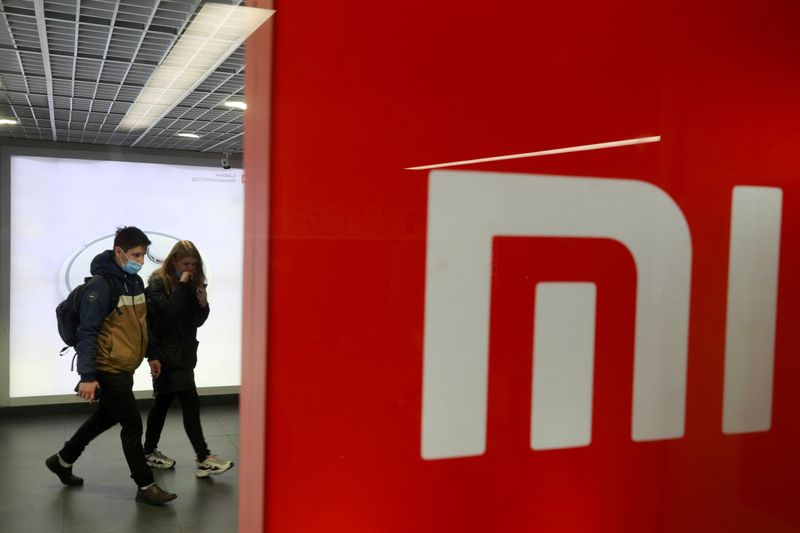FILE PHOTO: People wearing protective face masks visit Xiaomi brand's store in Kyiv