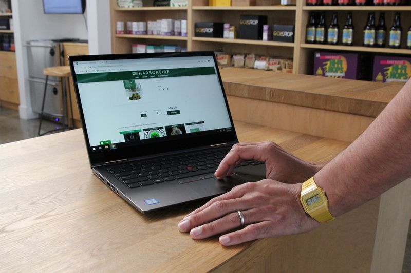 The website for Harborside is shown on a screen at the dispensary in San Leandro
