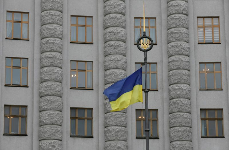 FILE PHOTO: A Ukrainian national flag flies in front of government building in central Kiev