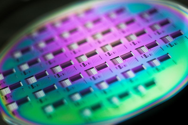 FILE PHOTO: A silicon wafer is pictured during the media presentation of the Guardian Angels project in one of the low particle pollution nanofabrication clean rooms of the Swiss Federal Institute of Technology  in Ecublens
