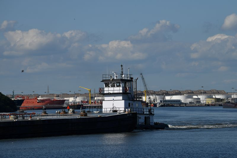 FILE PHOTO: A barge travels through the Houston Ship Channel, part of the Port of Houston, in Pasadena