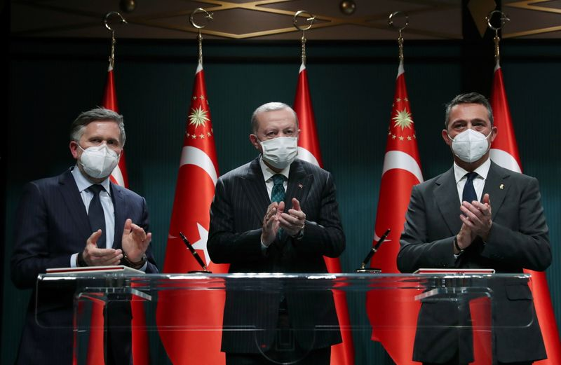 Turkish President Erdogan, Ford of Europe's head Rowley and Ford Otosan Chairman Koc attend a signing ceremony in Ankara