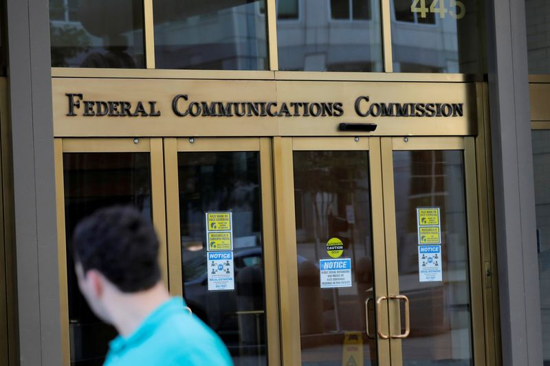 FILE PHOTO: Signage is seen at the headquarters of the Federal Communications Commission in Washington, D.C.