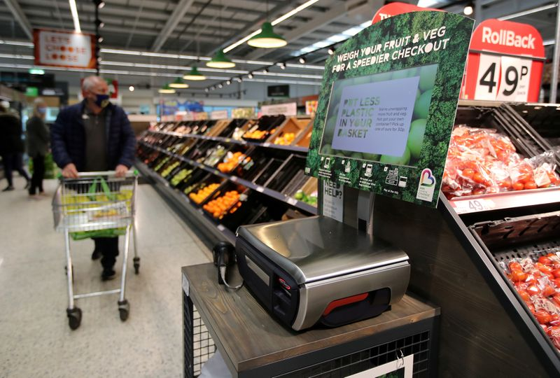 FILE PHOTO: Scales to weigh loose fresh produce are seen in the UK supermarket Asda in Leeds