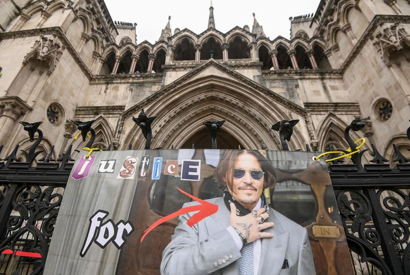 Poster placed by a supporter of actor Johnny Depp is seen at the High Court in London