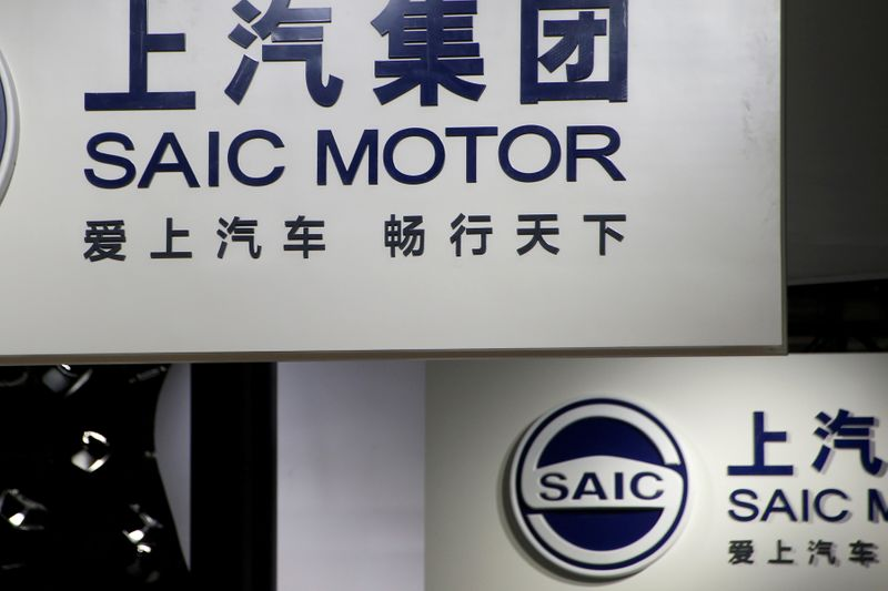 FILE PHOTO: SAIC Motor Corp's logos are pictured at its booth during the Auto China 2016 auto show in Beijing