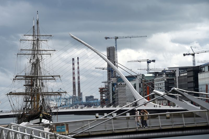 FILE PHOTO: Cranes are seen along the skyline in the Irish Financial Services Centre in Dublin