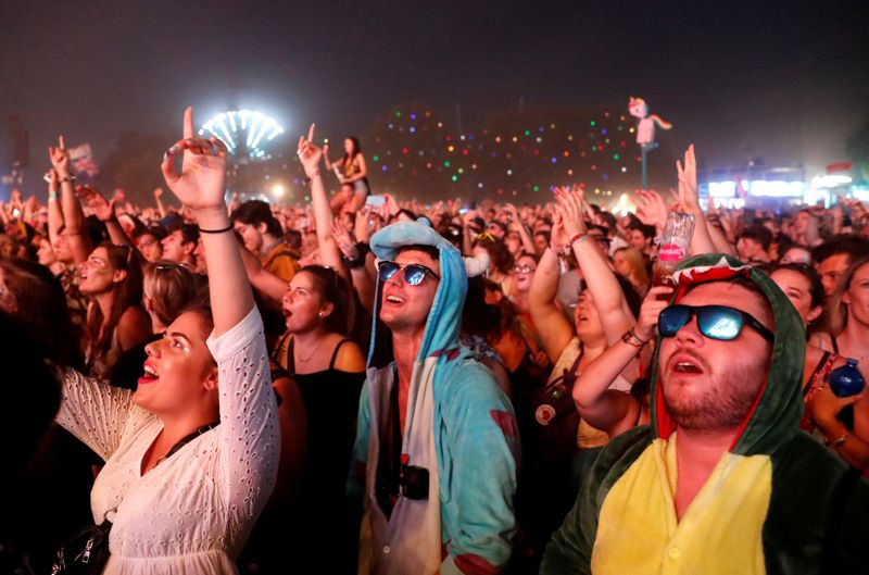 FILE PHOTO: Festivalgoers attend the Sziget music festival on an island in the Danube River in Budapest