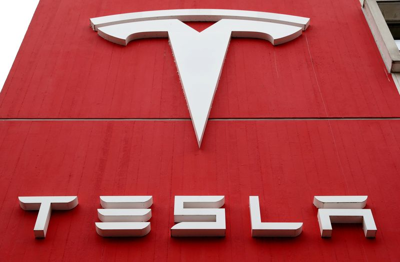 FILE PHOTO: A Tesla sign at the carmaker's branch office in Bern, Switzerland