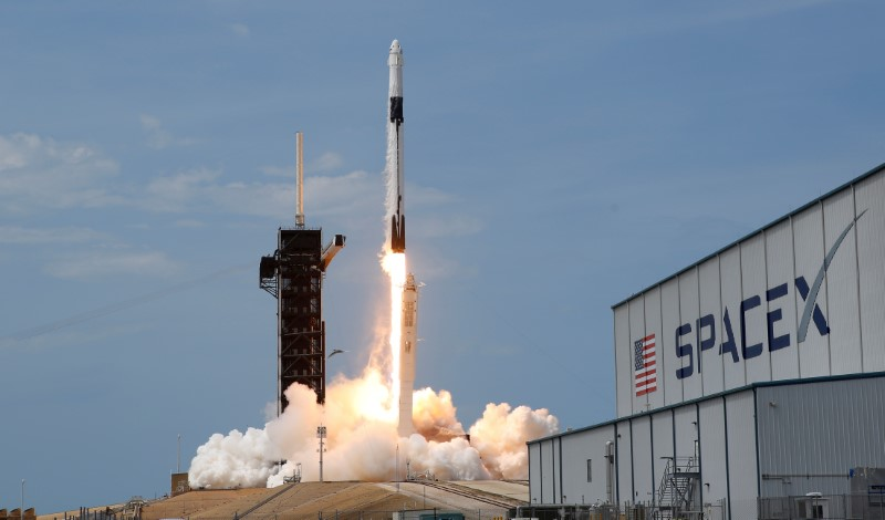 FILE PHOTO: A SpaceX Falcon 9 rocket and Crew Dragon spacecraft carrying NASA astronauts Douglas Hurley and Robert Behnken lifts off