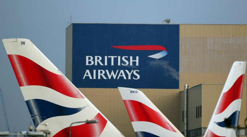 FILE PHOTO: British Airways logos are seen on tail fins at Heathrow Airport in west London