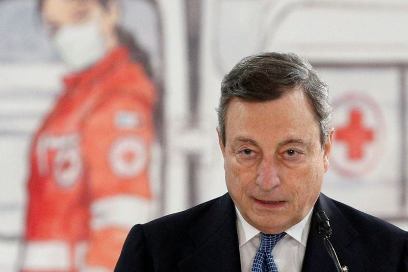 FILE PHOTO: Italian PM Draghi visits a mass vaccination centre at Fiumicino Airport near Rome