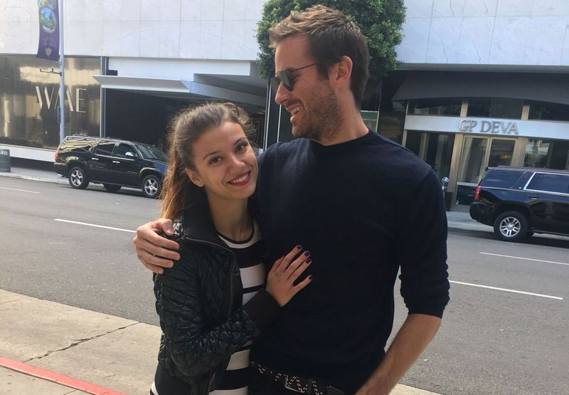 Handout photo shows a woman who identified herself only as Effie stands next to U.S. actor Armie Hammer